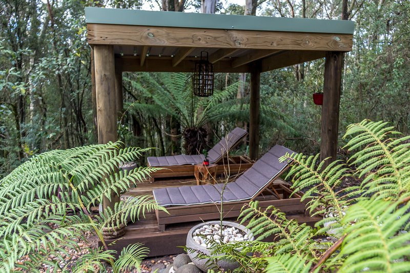 Relax on the day beds in the Japanese inspired gardens