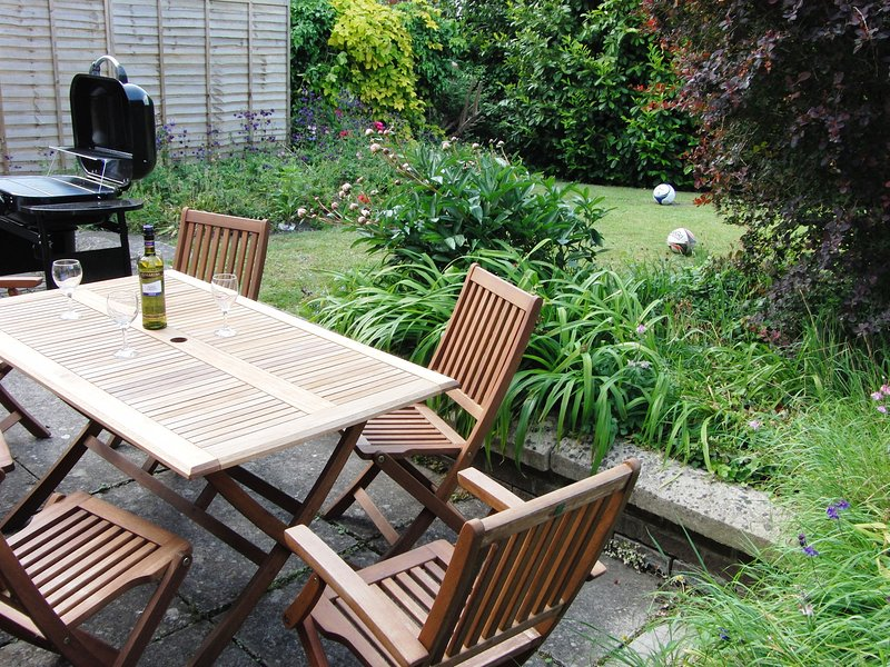Relax with a glass of your favourite drink on the sunny patio