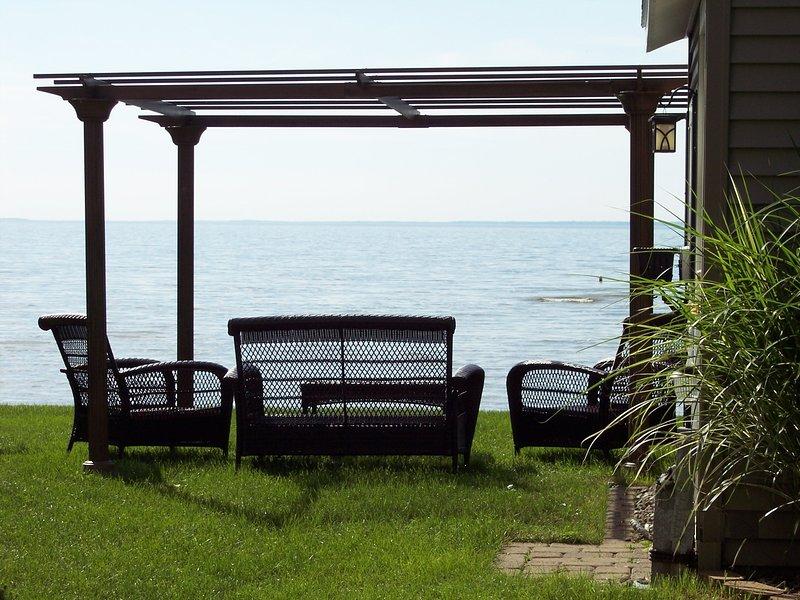 High End Outdoor Wicker Furniture Set Under Pergola Overlooking Beach