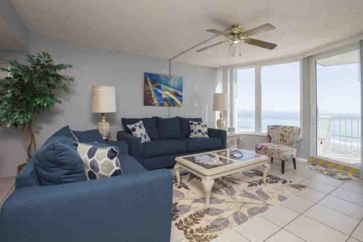 Living room with spectacular ocean views w/ balcony access