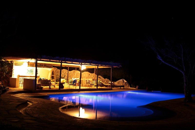 Poolhouse à noite