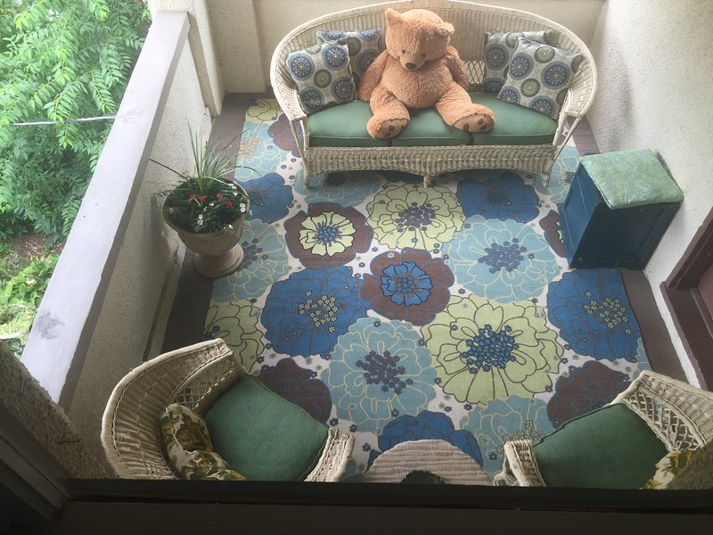 Second floor side porch, life sized bear optional!
