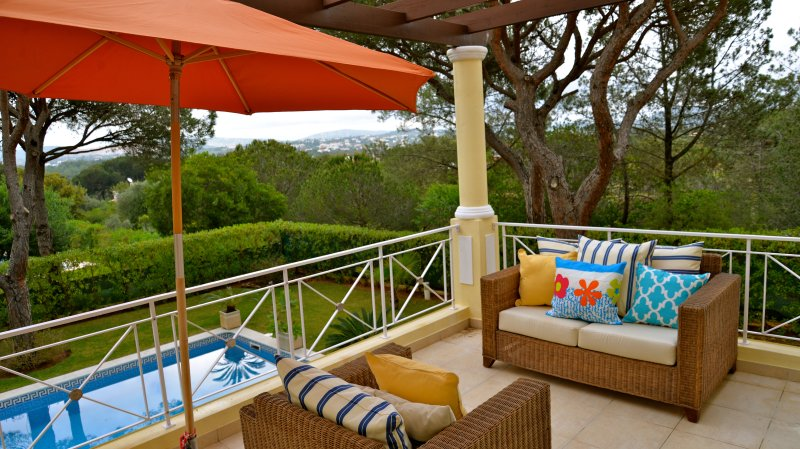 Balcony overlooking the pool with beautiful mountain views