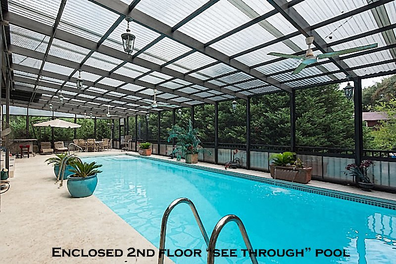 Swimming pool on 2nd floor-see through roof   w/windows/screens...no rain or bugs. A diving pool