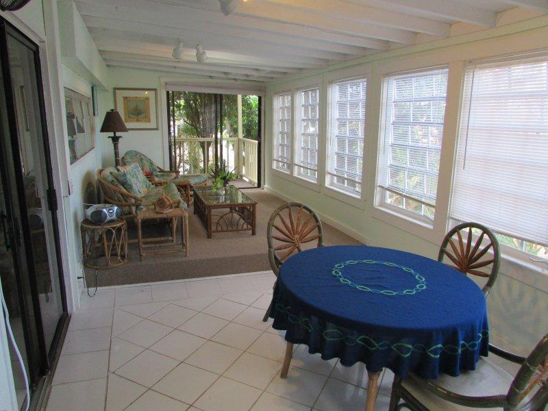 Spacious enclosed veranda with views of the ocean.