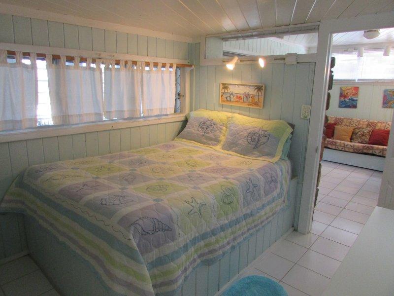 Comfortable queen bed in a/c room.