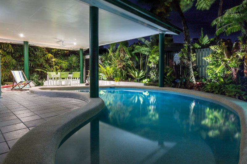 Poolside view at night, loose yourself amongst the tropical gardens.