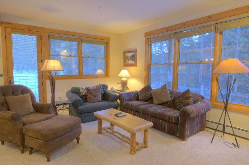 SkyRun Property - '8782 Trappers Crossing' - Living Room - Relax after a long day in the spacious living room in front of the roaring gas fireplace.