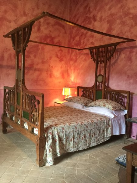 Room with antique four-poster bed, silk and cotton linens, and down the Tuscan linen ....