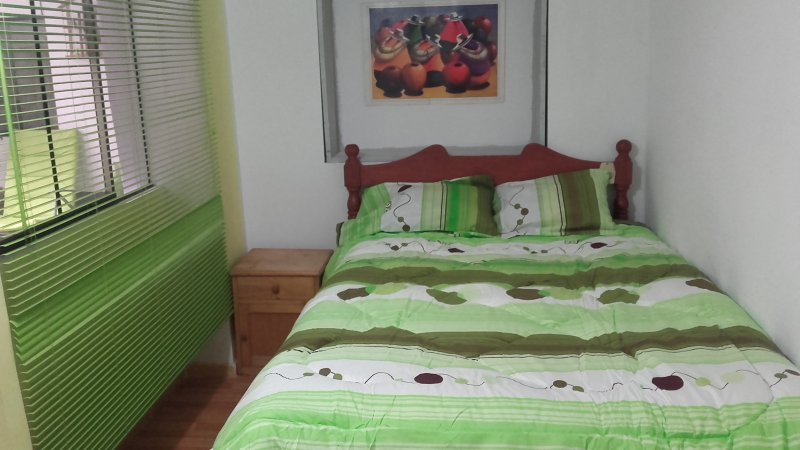 Double room with double bed with shared bathroom