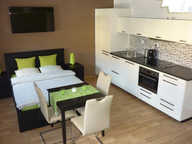 double bed (140cm), kitchen unit, smart TV
