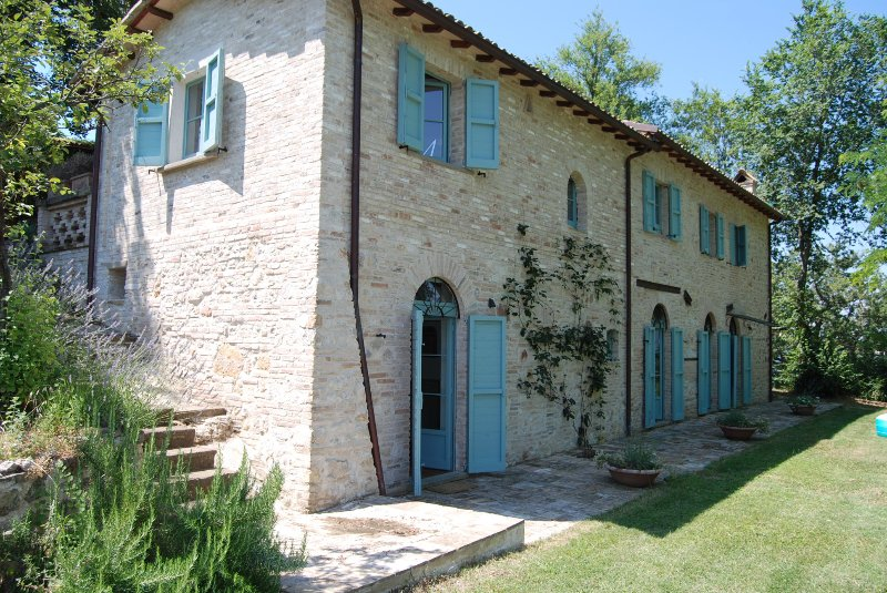 Casa Poggio from the lower terrace. Built into the lee of a hill, bedrooms are downstairs - and cool