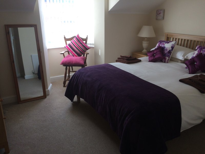 Light and spacious King Size Master Ensuite with Egyptian cotton bedding, TV with DVD player.