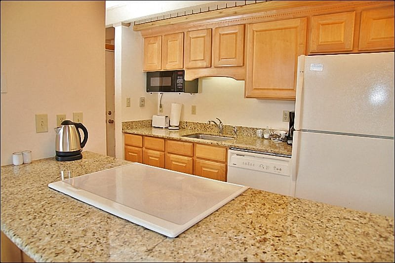 Kitchen features New Granite Counters, Appliances, Cabinets