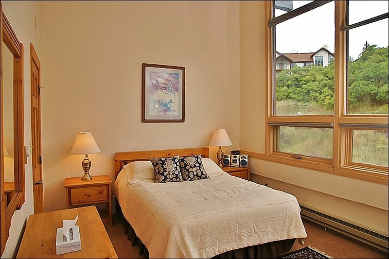 Bedroom 2 - Queen Bed, Vaulted Ceilings, Reading Chair