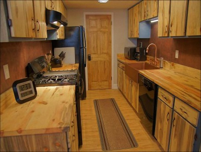 Beetle Killed Pine Cabinetry, Butcher Block counters, Gas Range, Copper Sink