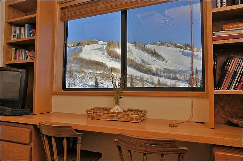Wake up to slope views or try to get some work done at the desk