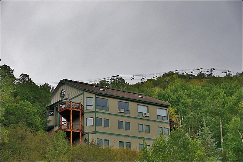 Exterior of the home with the Christie Lifts in the background & View from the home