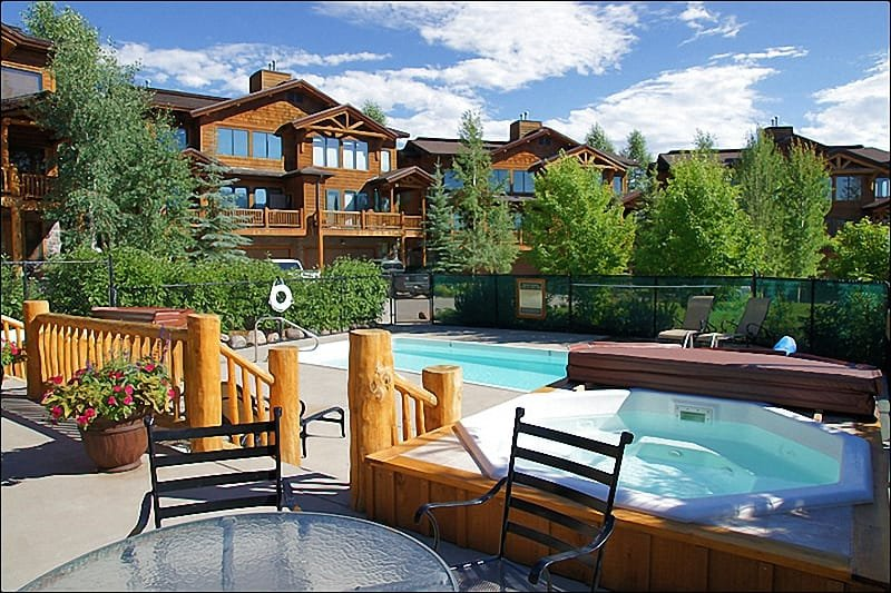 Heated Pool, Hot Tubs, Sunbathing Furniture & Exterior View of the home.