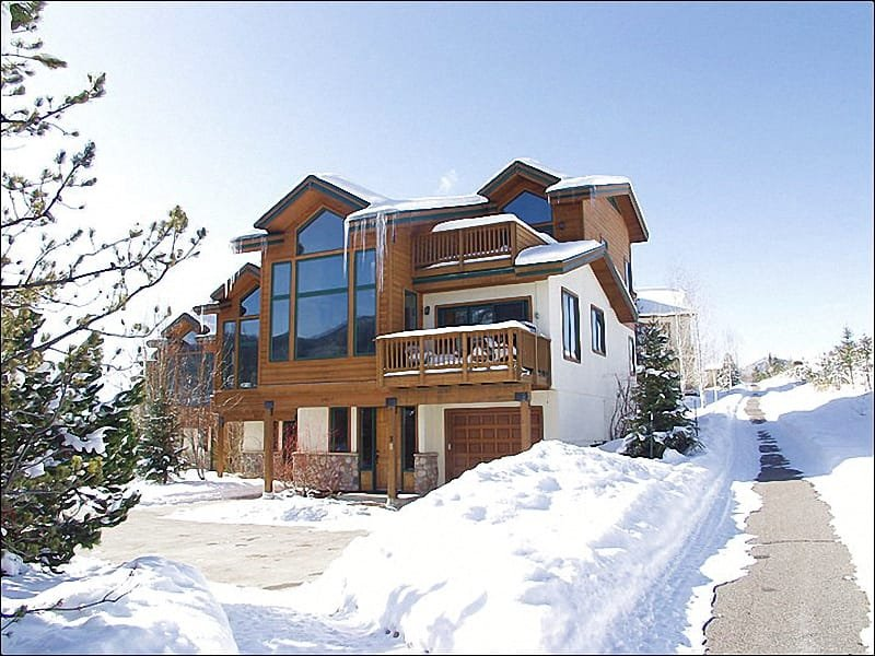 Exterior View of this End-Unit townhome shows multiple balconies & huge windows.