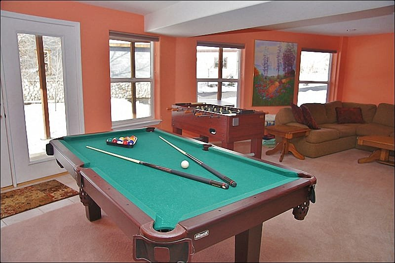 The Lower Living Room features a Pool Table!