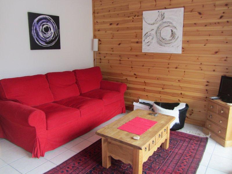 Salón con sofá cama grande