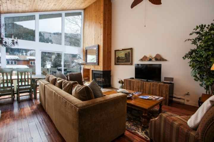 Warm decor in the living room with 48' flat screen TV, Blu Ray DVD player and wood burning fireplace.
