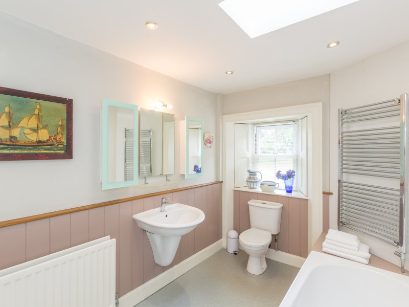 One of two spacious bathrooms with bath and shower cubicle.