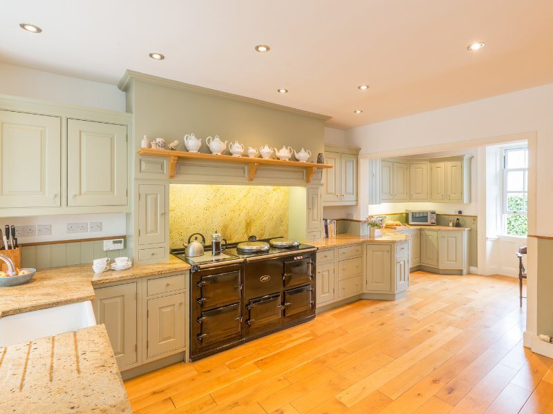 Farmhouse kitchen with electric Aga and granite worktops.