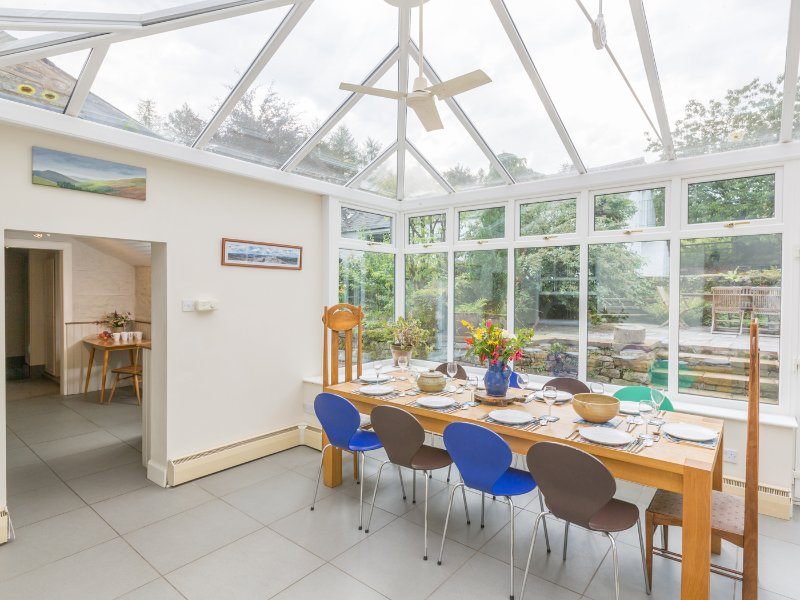 Dining table for 10 in the conservatory next to the kitchen.
