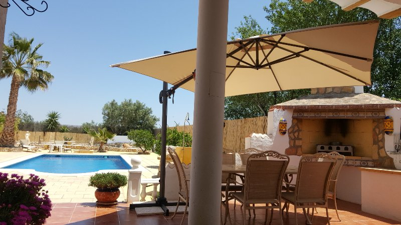 Barbeque on terrace overlooking the pool