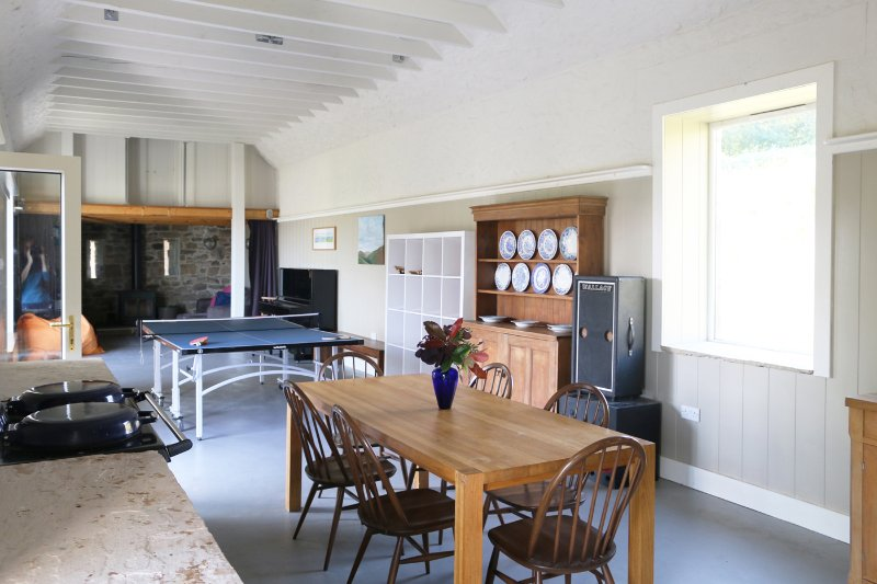 Barn with table tennis and TV area with wood burning stove.