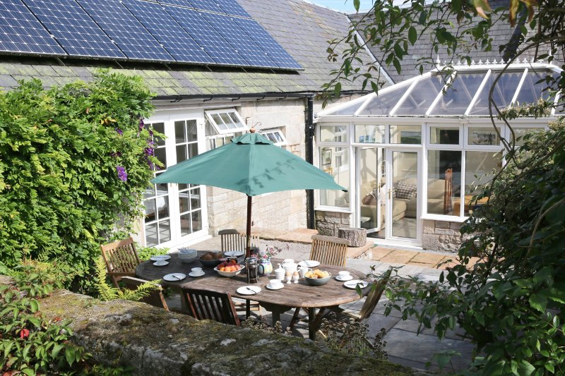 Courtyard area with garden furniture - perfect for breakfast in the sun.