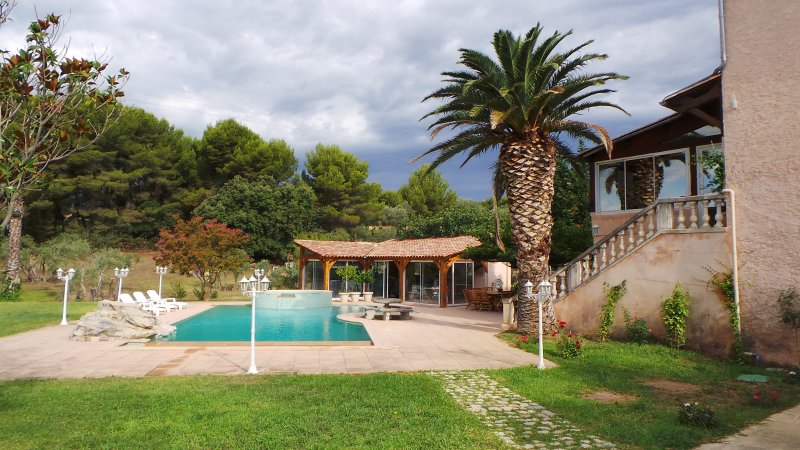 Half a hectare of land with grass and olive trees surrounding the house.