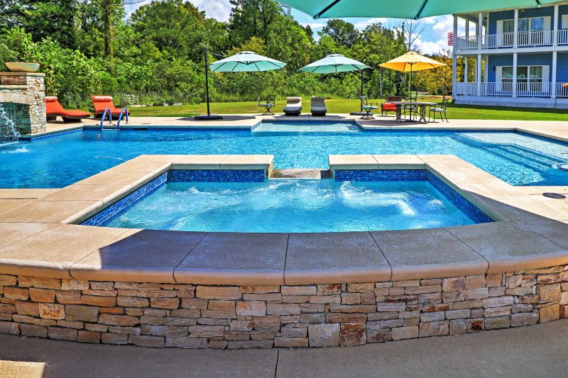 Soak up the sun while lounging in the poolside patio area.