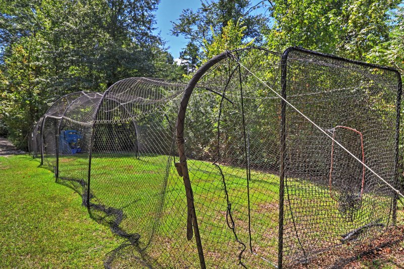 Practice your swing in the batting cage.