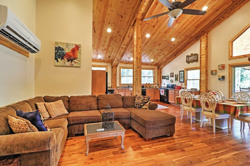 Lounge around on the comfy couches in the spacious living room.