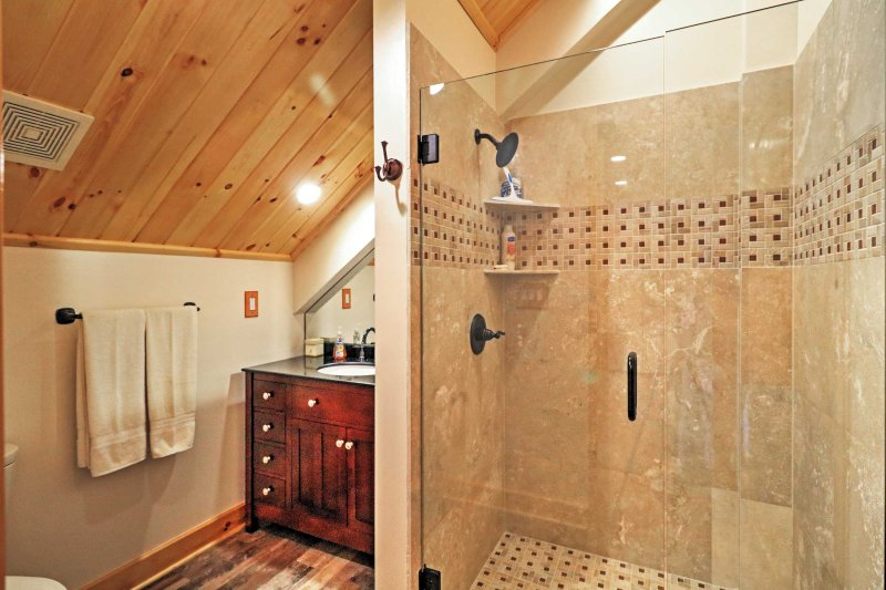 Clean off in the walk-in shower after a long day of outdoor activities.