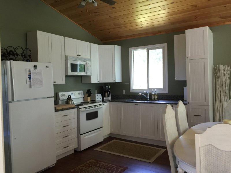 The kitchen has a fridge, stove, microwave, and all utensils that you need to create meals together