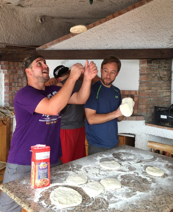 Happy guests making their own pizza in the Cottage with its authentic wood burning oven
