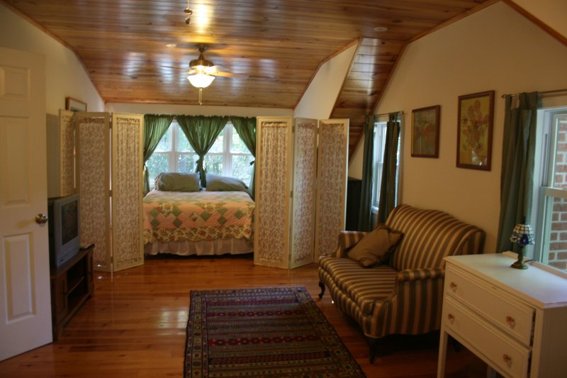 2nd level Green Bedroom has two twin beds, TV viewing in the center and a queen bed opposite