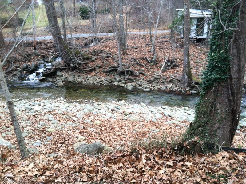 Different view of the Robinson River.  Outbuilding is used for storage and is unoccupied.