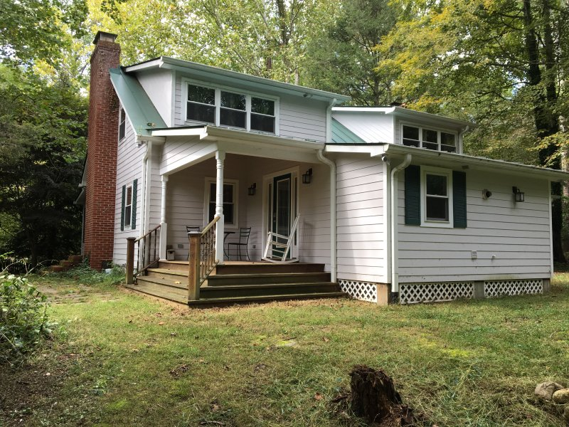 House has a front porch, river facing deck, and a back patio.  Two levels.