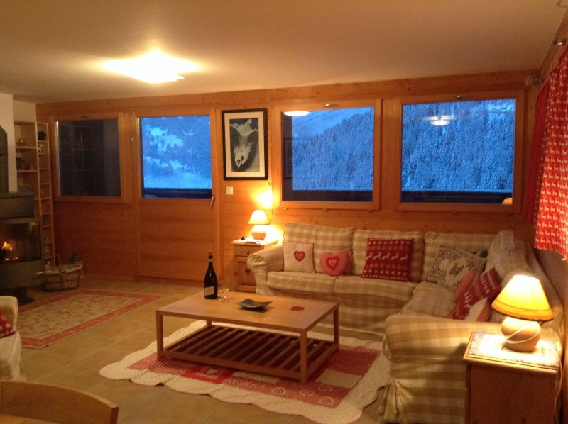 Spacious lounge with wood burning stove and panoramic views.