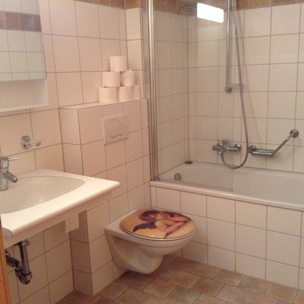 Modern Bathroom with full size bath and overhead shower. Towels provided