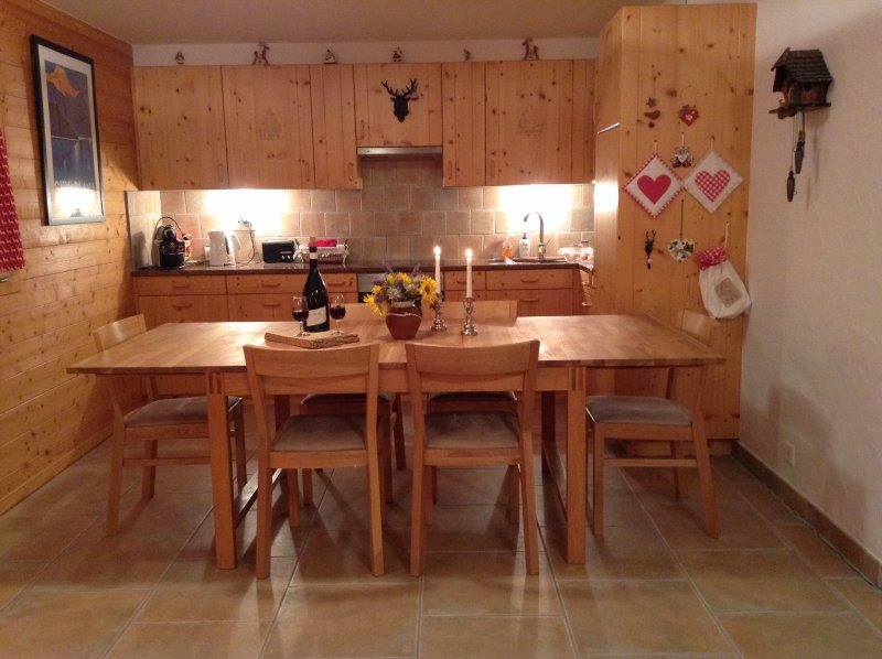 Open plan dining and ful.ly equipped kitchen