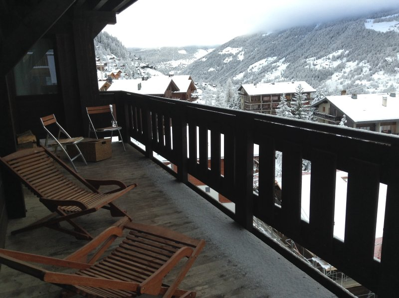 Large balcony with open views across both the village and far mountains of St Luc.