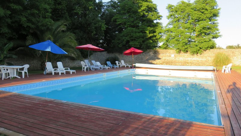 The gorgeous solar-heated pool, fenced and gated. You will love it.
