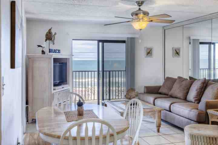 Open living room with breathtaking views of Ormond's serene beach