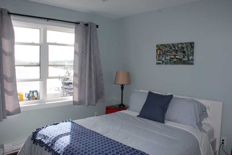 Main Floor Queen bedroom overlooking the harbour and city